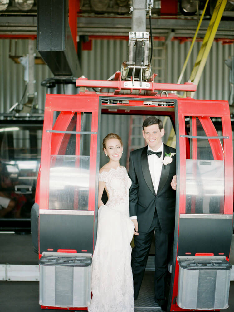 bride and groom getting on the Aspen gondola photo by Tara Marolda