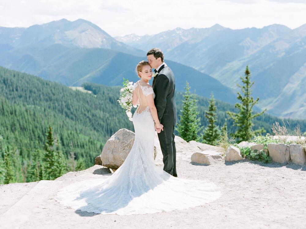 Aspen Wedding bride and groom on Aspen Mountain photography by Tara Marolda