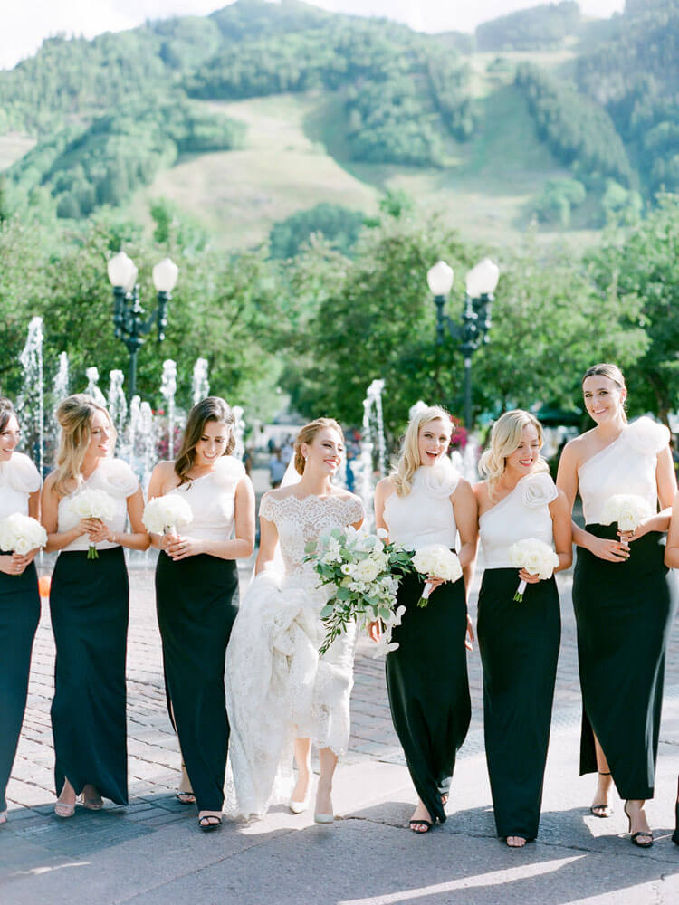 bride with bridesmaids photoshoot in downtown Aspen photo by Tara Marolda