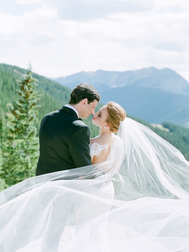 Aspen Wedding bride and groom embracing on Aspen Mountain photography by Tara Marolda