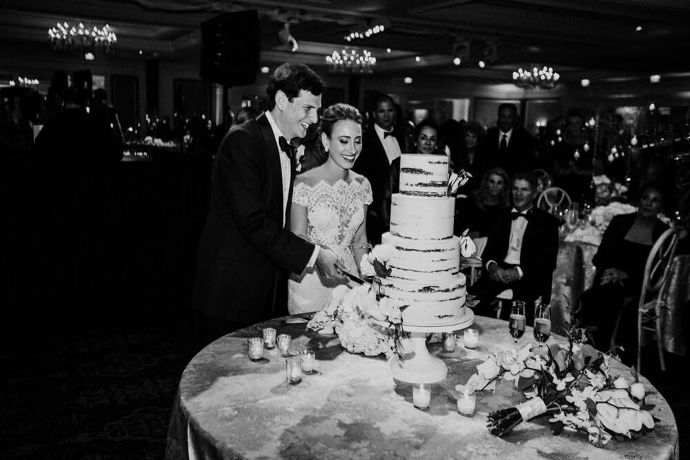 Aspen Wedding Reception bride and groom cutting cake photography by Tara Marolda