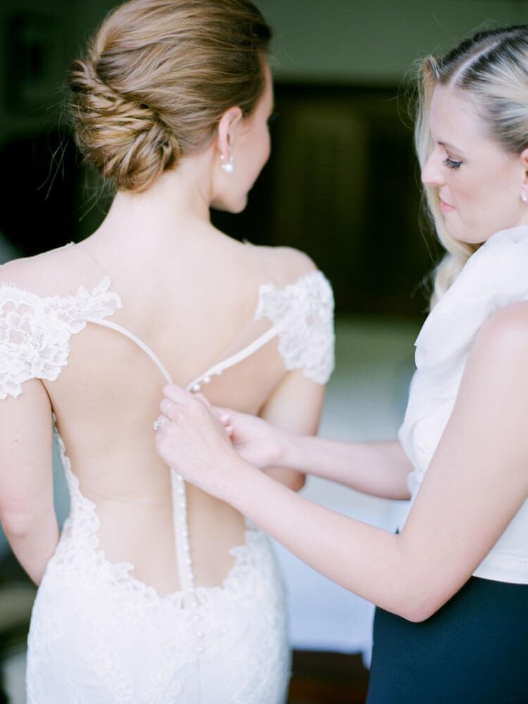 Aspen Mountain Wedding bride and bridesmaid getting ready photography by Tara Marolda