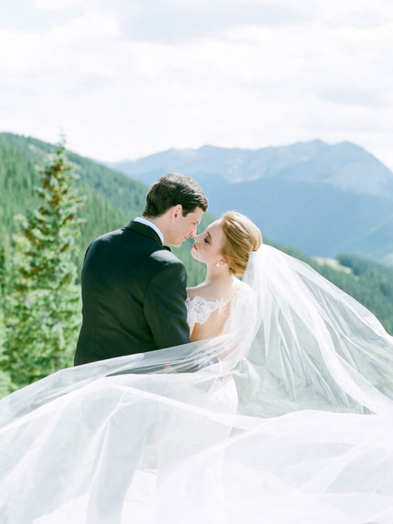 Magical wedding photo taken on top of Aspen mountain by Tara Marolda