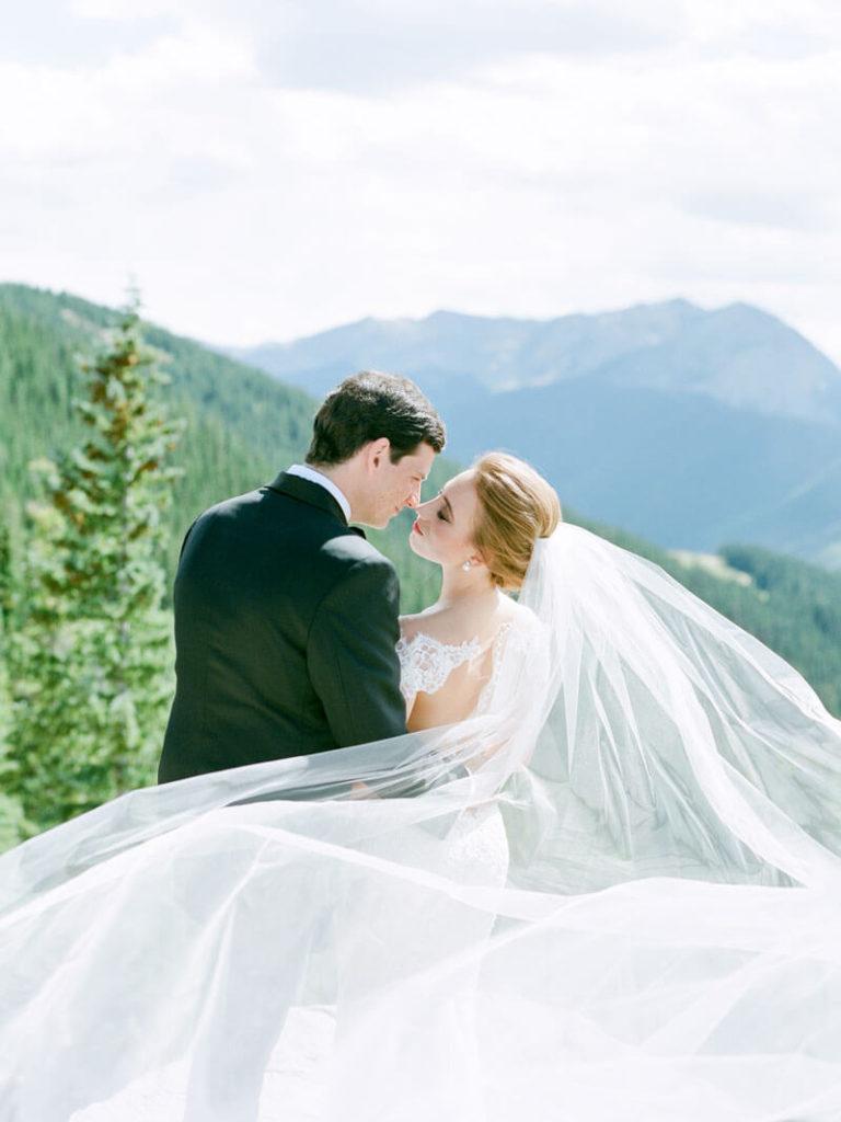 Magical wedding photo taken on top of Aspen mountain by Tara Marolda